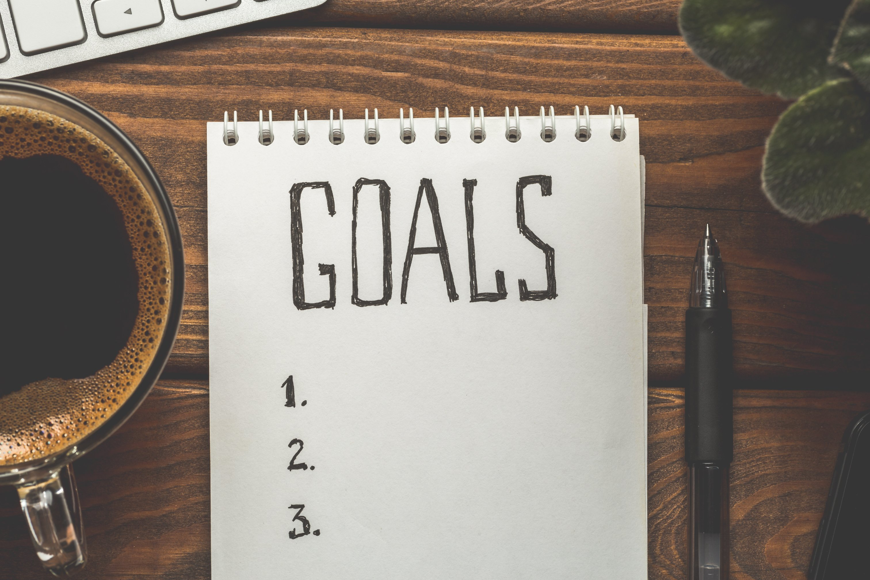 Image of a notepad with Goals as the title