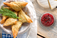 Image of turkey, brie and cranberry triangles